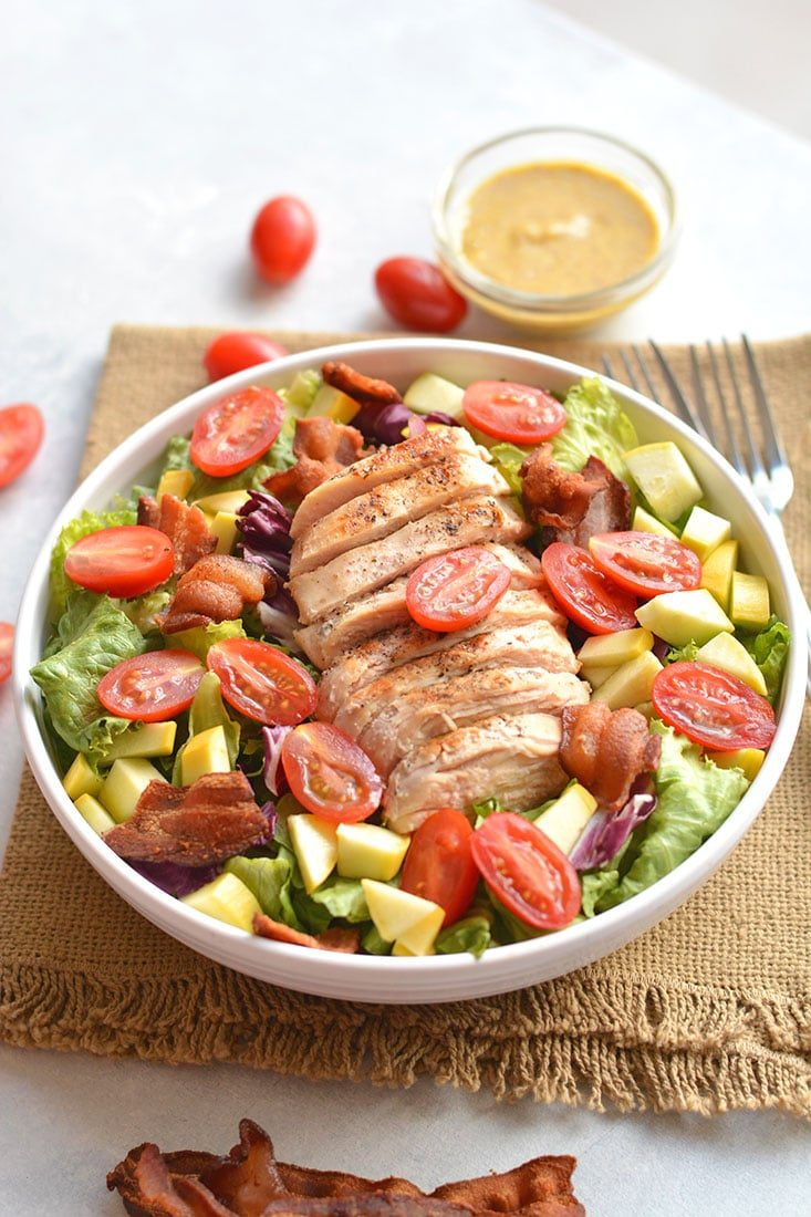 A classic BLT Grilled Chicken Salad! Freshlettuce topped with tomatoes, squash, crispy bacon & drizzled in a balsamic mustard dressing! Great for lunch or dinner! Gluten Free + Low Calorie + Paleo