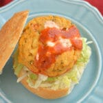 Healthy Fish Sandwiches with a serious kick! A light, easy, Paleo friendly baked cod recipe served withSriracha Greek yogurt for a flavorful, low carb meal. Packed with omega-3's & freezer friendly! Gluten Free + Low Calorie + Paleo