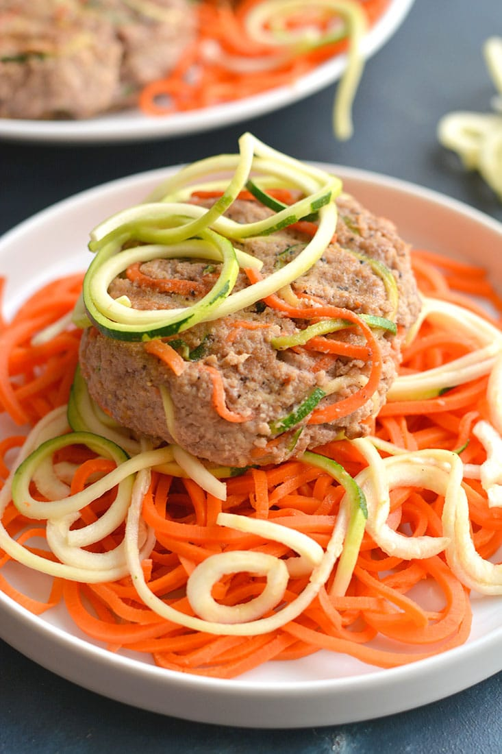 Spiralized Turkey Burgers with Zucchini & Carrots! These burgers make a bold statement with curly strands of veggies. With 4 ingredients & 10 minutes to make, this veggie packed recipe is one anyone can make. Paleo + Gluten Free + Low Calorie