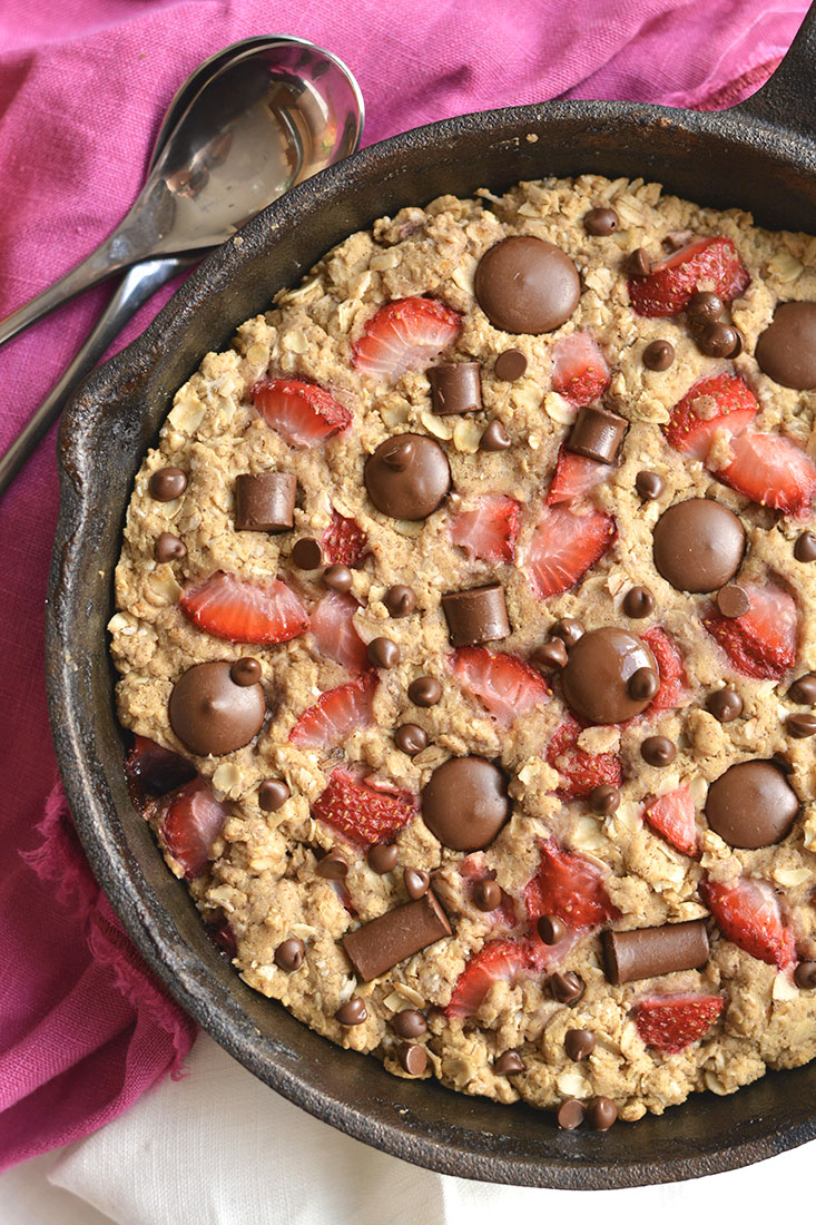 Gooey, Chocolatey Strawberry Chocolate Chip Skillet Cake! Low sugar & made with healthier, wholesome ingredients, you will fall in love with this indulgent weight watcher friendly dessert! Gluten Free + Low Calorie