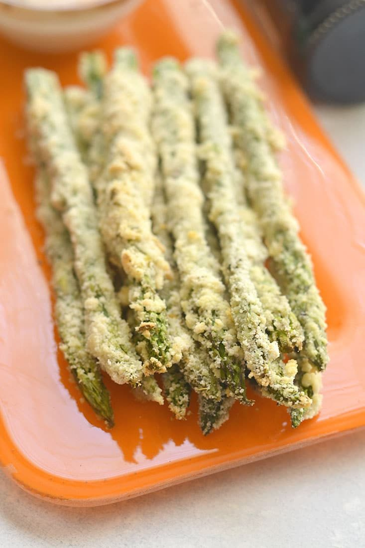 Eat more veggies! This Almond Crusted Asparagus with Soy Yogurt recipe is an easy way of flavoring boring veggies so you'll want to eat more of them. Paired with a simple Greek yogurt dipping sauce to dip your asparagus fries into for a simple & tasty side or appetizer. Gluten Free + Low Calorie
