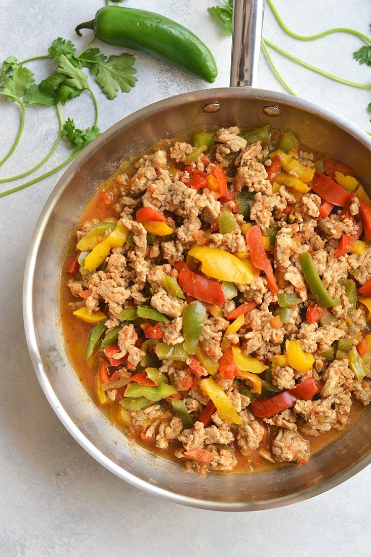 Healthy Skillet Salsa Chicken! Loaded with protein, veggies & flavor, this super easy 15 minute dinner is a family favorite. Serve over lettuce with rice or quinoa, or cauliflower rice for Paleo. Gluten Free + Low Calorie + Paleo