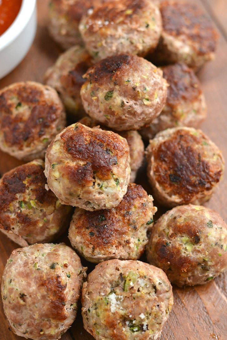 Healthy Zucchini Parmesan Meatballs! Baked in less than 30 midnutes & freezable. These meatballs are perfect for meal prepping, a quick weeknight dinner or serving as an appetizer. Gluten Free + Low Calorie