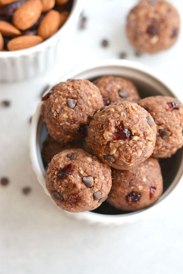These Vegan Chocolate Almond Cranberry Bliss Bites are a must make for healthy snacking! Super simple to make with only 7 ingredients. No baking required! Gluten Free + Paleo + Vegan + Low Calorie