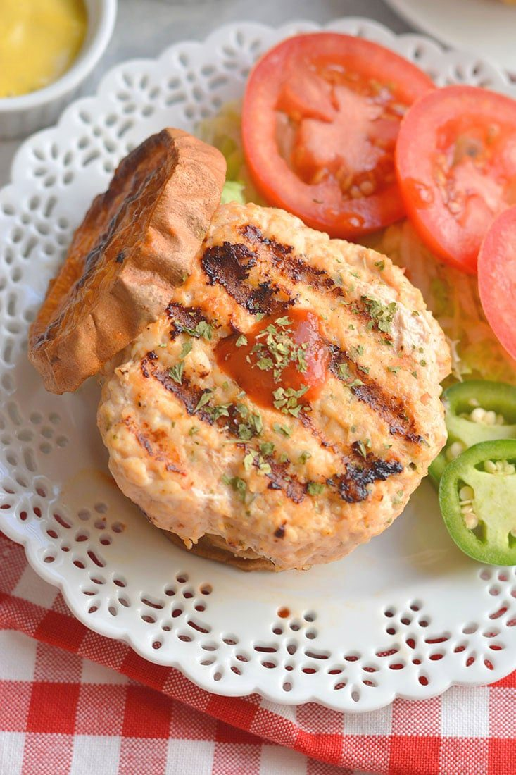 Grilled Sriracha Parsley Chicken Burgers! Sriracha &parsley mixed with chicken, make these burgers to die for! These flavorful, herby, burgers have a hidden kick & can be made on the stove, grill or in the oven. Paleo + Gluten Free + Low Calorie