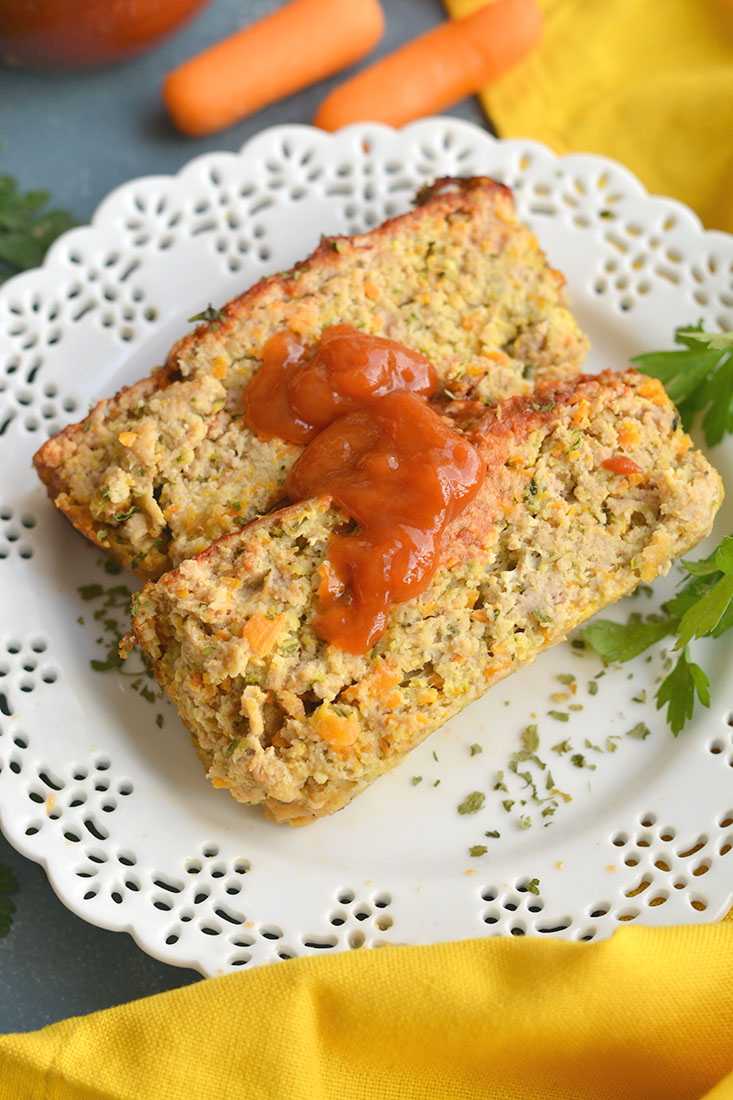 Savory Paleo Carrot Zucchini Meatloaf! A classic recipe gets a healthy makeover as a leaner, low carb, protein-packed meal. Bonus, all veggies included! Great for meal prepping for lunch or dinner! Gluten Free + Low Calorie + Paleo