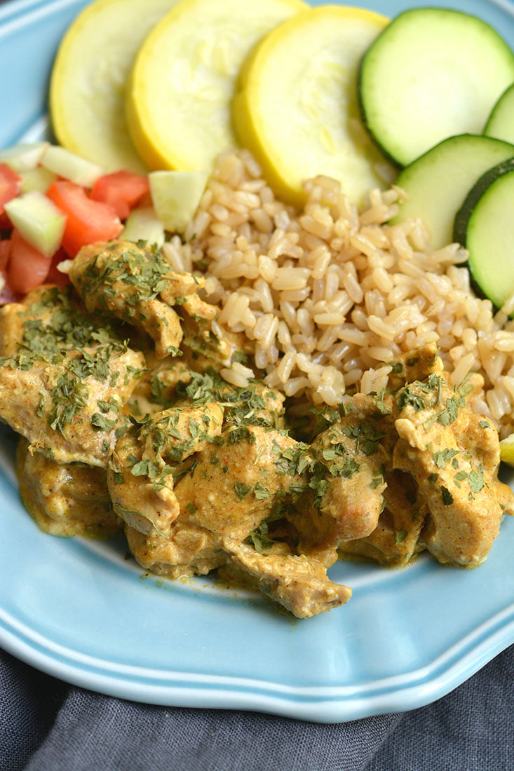 This Crockpot Chicken Shawarma is a hearty mealpacked with Mediterranean flavors. A quick slow cooker recipe, just dump and go. High protein and feeds plenty. Gluten Free + Low Calorie