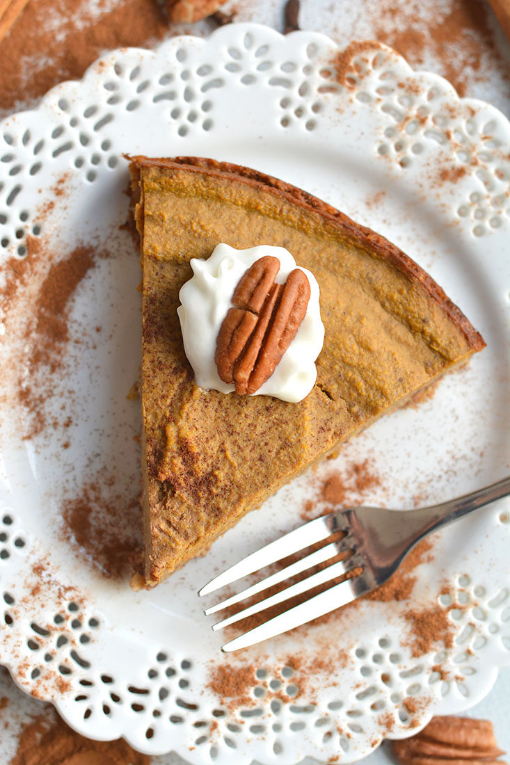 Skinny Pumpkin Pie! Made with a pecan oat crust and topped with a lightly sweetened pumpkin custard. This pumpkin pie is incredibly easy to make, flavorful and perfect for getting a pumpkin fix. Gluten Free + Low Calorie