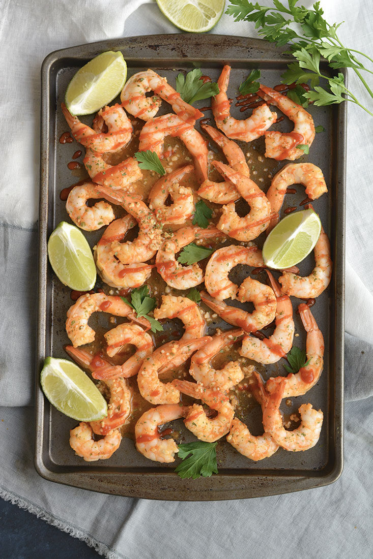 Spicy Sriracha Shrimp made two ways! Tender shrimp tossed in garlic, lime and Sriracha then cooked to perfection. A low carb, Gluten Free and Paleo meal made in less than 15 minutes! Gluten Free + Low Calorie + Paleo