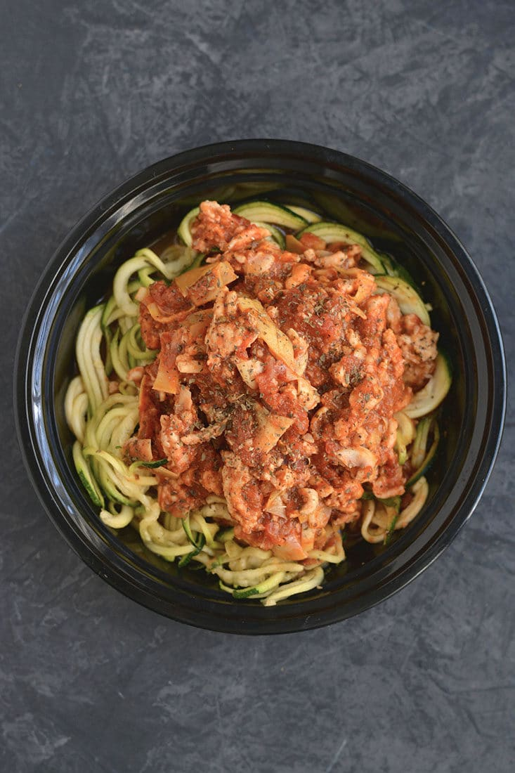 Meal Prep Bolognese with Zucchini Noodles! Healthy bolognese made with zucchini noodles & artichokes in 15 minutes. A classic recipe made over with simple ingredient swaps. EASY for meal prepping a healthy lunch or dinner. Gluten Free + Low Calorie + Paleo