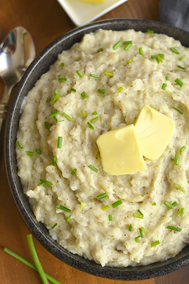 Healthier Mashed Potatoes & Cauliflower! This lighter version of the traditional dish adds cauliflower & Greek yogurt that no one will notice. A healthier side for your dinner table! Gluten Free + Low Calorie