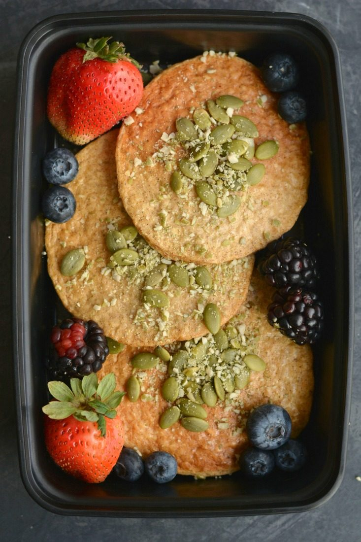 Meal Prep Pumpkin Protein Pancakes! Fluffy, fall flavored pancakes with nearly 6 grams of protein each. EASY to meal prep in advance or freeze for a quick, healthy & balance breakfast. Gluten Free + Low Calorie