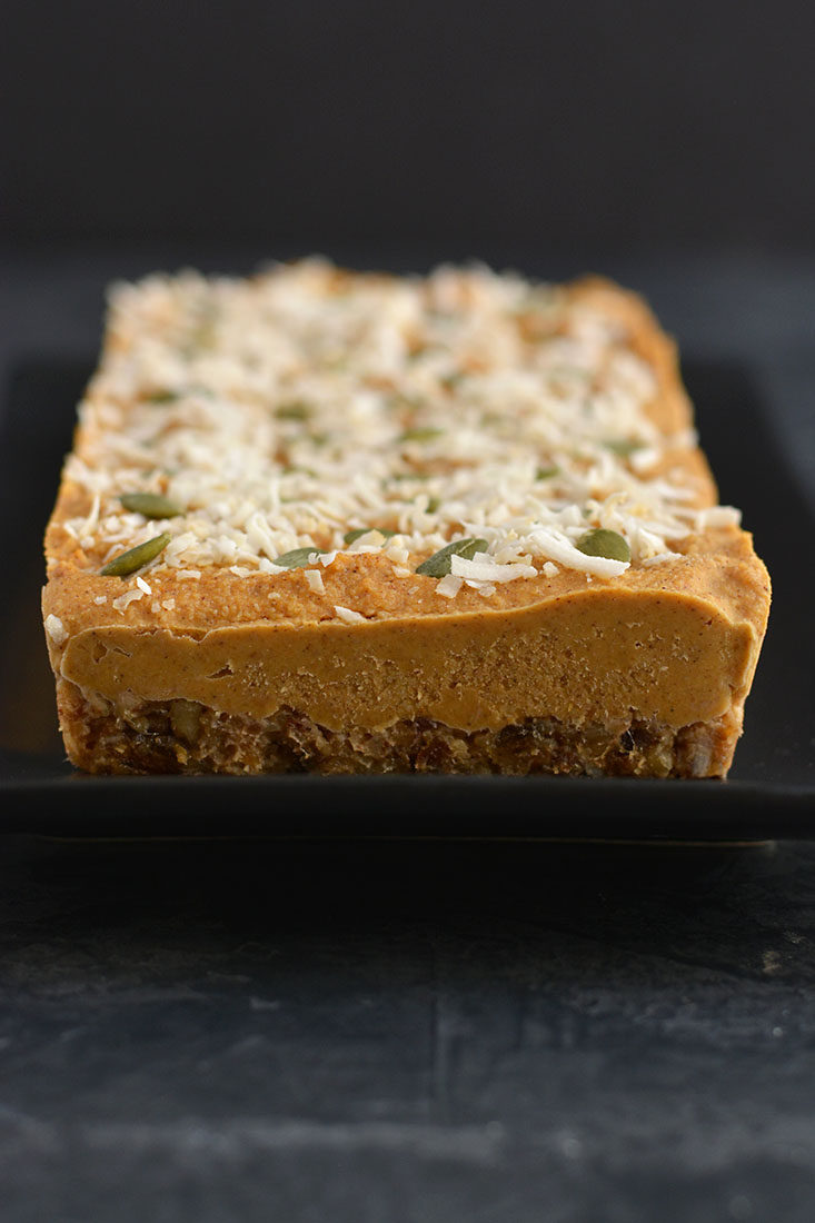 Raw Pumpkin Pie! Made with a walnut, date base & topped with a creamy, cashew pumpkin custard, this is what pumpkin pie dreams are made of. No baking required! Serve as a dessert or healthy snack. Paleo + Vegan + Low Calorie