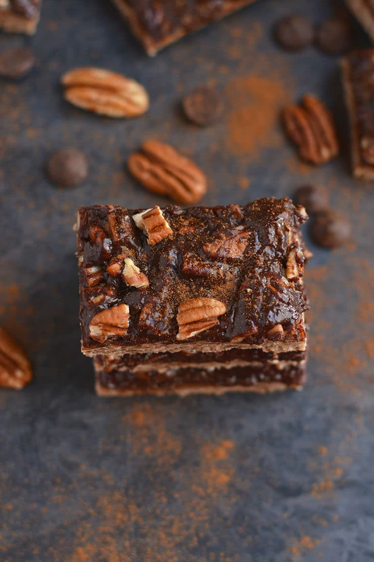 Chocolate Pecan Pie Bars! A healthy spin on pecan pie made free of gluten & refined sugar. EASY to bake & perfectly portioned for those watching their weight! Vegan + Gluten Free + Low Calorie