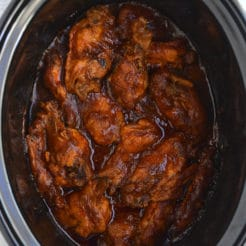 Healthy Crockpot BBQ Wings! All the spicy flavor you love in chicken wings packed in a healthy, low sugar BBQ sauce. The perfect game day appetizer, party favor, or dinner for healthy eaters! Gluten Free + Paleo + Low Calorie