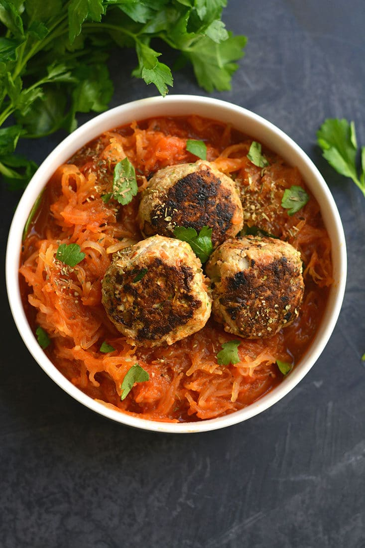 Meal Prep Spaghetti Squash & Meatballs! A traditional recipe gets a low carb swap & pair with veggie loaded meatballs for a high protein lunch or dinner! Paleo + Gluten Free + Low Calorie