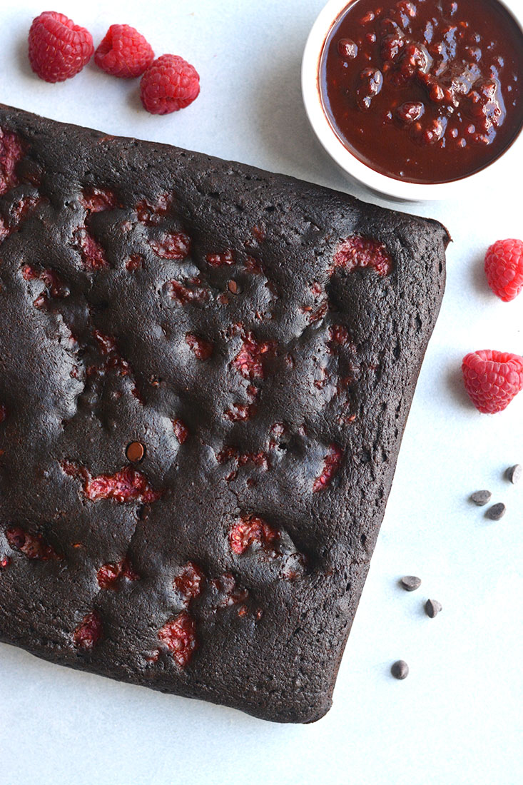 Paleo Raspberry Cacao Brownies! Made gluten free, dairy free and nut free! A deliciously sinful tasting dessert that's healthy and quick to make! Top with a raspberry chocolate sauce for more chocolatey goodness! Paleo + Gluten Free + Low Calorie