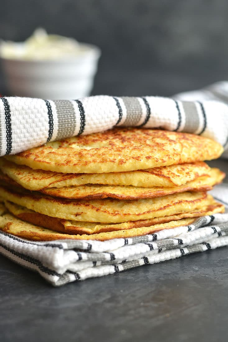 Homemade 3-ingredient Cauliflower Tortillas! Made with eggs, cauliflower and garlic, these grain-free tortillas are easy to make and customizable.They are perfect as a gluten free substitute for wraps and tortillas. They also double as breakfast fritters. Gluten Free + Paleo + Low Carb + Low Calorie