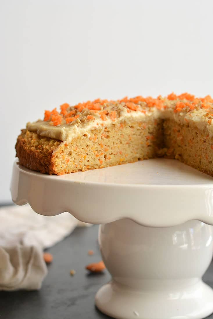 Paleo Almond Flour Carrot Cake! This carrot cake recipe is healthy super simple & quick to make. Topped with a cashew maple frosting that's irresistible. Soft, moist & dairy-free. Vegan option included! Paleo + Vegan