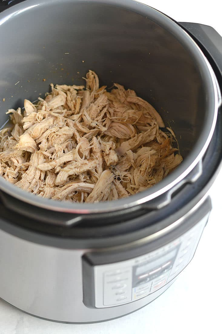 Instant Pot Shredded Chicken! Meal prep chicken in 20 minutes in an Instant Pot with only a few ingredients. Perfect for easy low carb lunches or weeknight dinners. Serve on a salad, over rice, in tacos, casseroles and more! Low Carb, Low Calorie, Paleo, Gluten Free