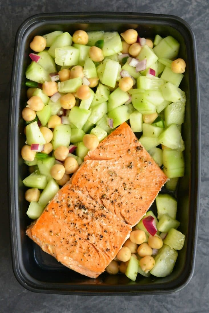 Meal Prep Salmon Cucumber Chickpea Salad! 10-minute skillet salmon paired with a light & fresh cucumber chickpea salad that has a kick of spice. This high protein meal is prepped in under 15 minutes making it perfect for a quick & easy meal prep! Low Calorie + Gluten Free