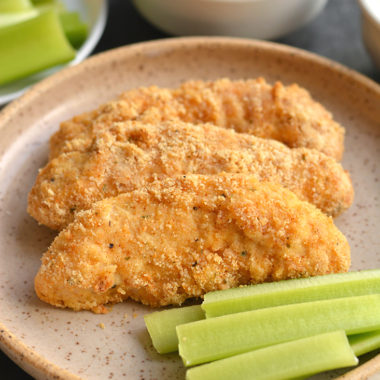 Almond Flour Buffalo Chicken Tenders! These better for you chicken tenders are made with healthy fat and protein from almond flour instead of traditional breadcrumbs that are higher in carbohydrates. This lighter meal is quick to make in under 30 minutes and healthier. Paleo + Gluten Free + Low Calorie