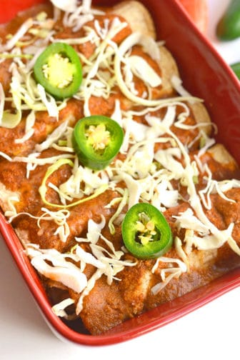High Protein Chicken Enchiladas! These skinny enchiladas are made with a few simple, healthy swaps. They are creamy on the inside and spicy on the outside. Only 320 calories per serving and made with real food! Gluten Free + Low Calorie