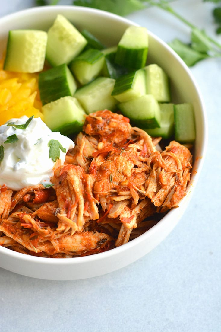 Instant Pot Harissa Shredded Chicken Bowls! This simple, healthy shredded chicken is cooked in under 30 minutes in an Instant Pot with Harissa for a spicy kick! Paired with sliced cucumber, bell pepper and Greek yogurt for a complete meal! Low Calorie + Gluten Free