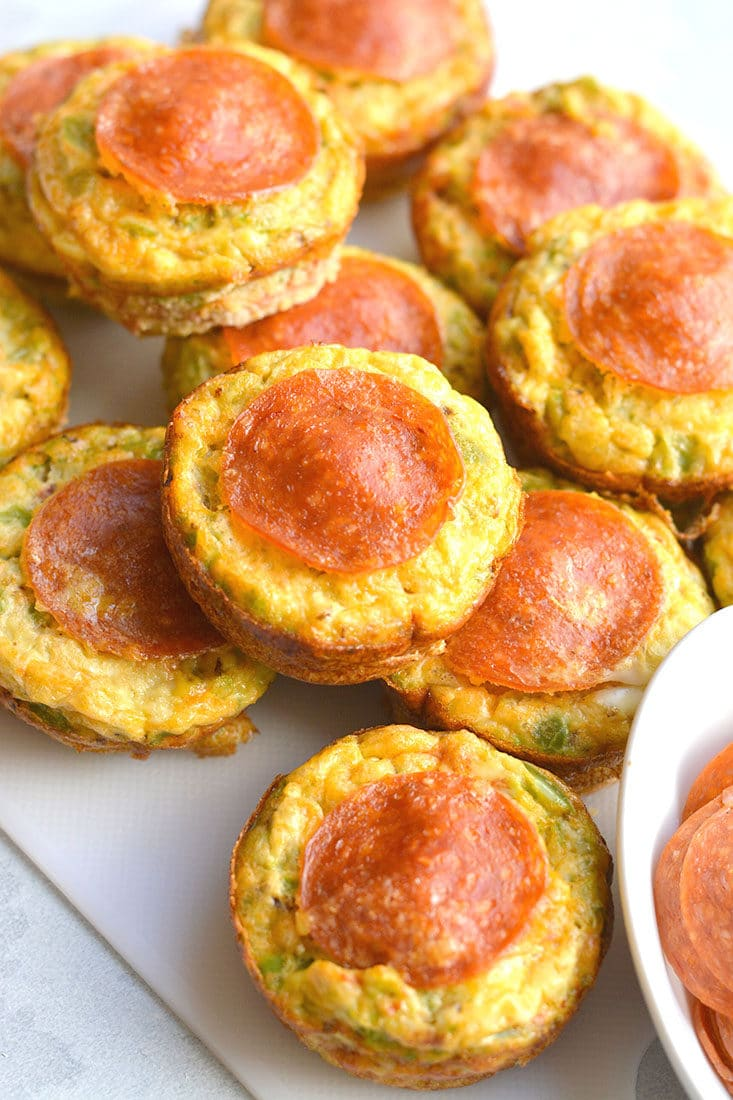 Skinny Pizza Egg Muffins! An easy recipe that makes a quick breakfast and healthy meal every morning. Packed with riced bell pepper and spices, these egg muffins are perfect for weekend meal prep. Wholesome, light and delicious! Gluten Free, Low Calorie, Paleo