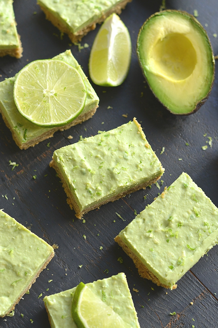 Avocado Key Lime Pie Bars! Made with a buttery gluten free oat crust that tastes like graham crackers and topped with creamy lime avocado Greek yogurt filling for an irresistible treat! A lighter twist on Key Lime Pie that's made with healthier ingredients and balanced in nutrition. Gluten Free + Low Calorie