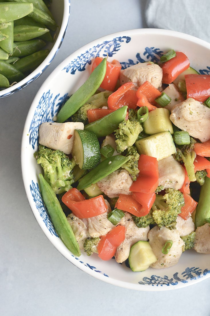 Clean Out The Fridge Chicken Veggie Stir Fry! Add any leftover veggies from the fridge, toss in chicken and soy free stir-free sauce for a quick and delicious meal! Naturally gluten fee and lower in carbs. Gluten Free + Paleo + Low Calorie