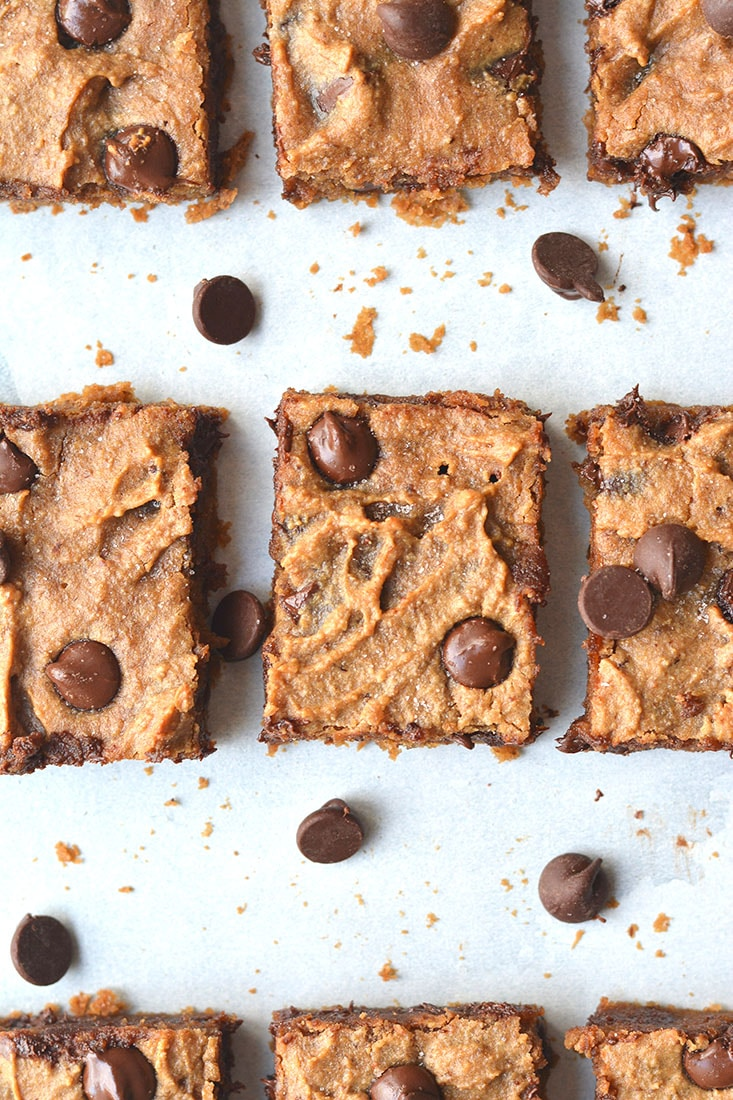 Healthy Peanut Butter Chocolate Blondes! This Vegan dessert recipe is low calorie, made with real peanut butter and topped with dairy free chocolate chips. The perfect, easy dessert recipe! Paleo option included. Gluten Free + Low Calorie + Vegan