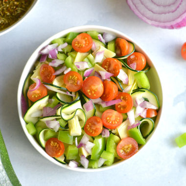 Paleo Zucchini Pasta Salad! Replace pasta with spiralized zucchini for a light, refreshing and filling pasta salad! A low carb pasta salad filled with vegetables. Pair with your favorite lean protein for a complete meal. Low Carb + Gluten Free + Paleo + Low Calorie + Vegan