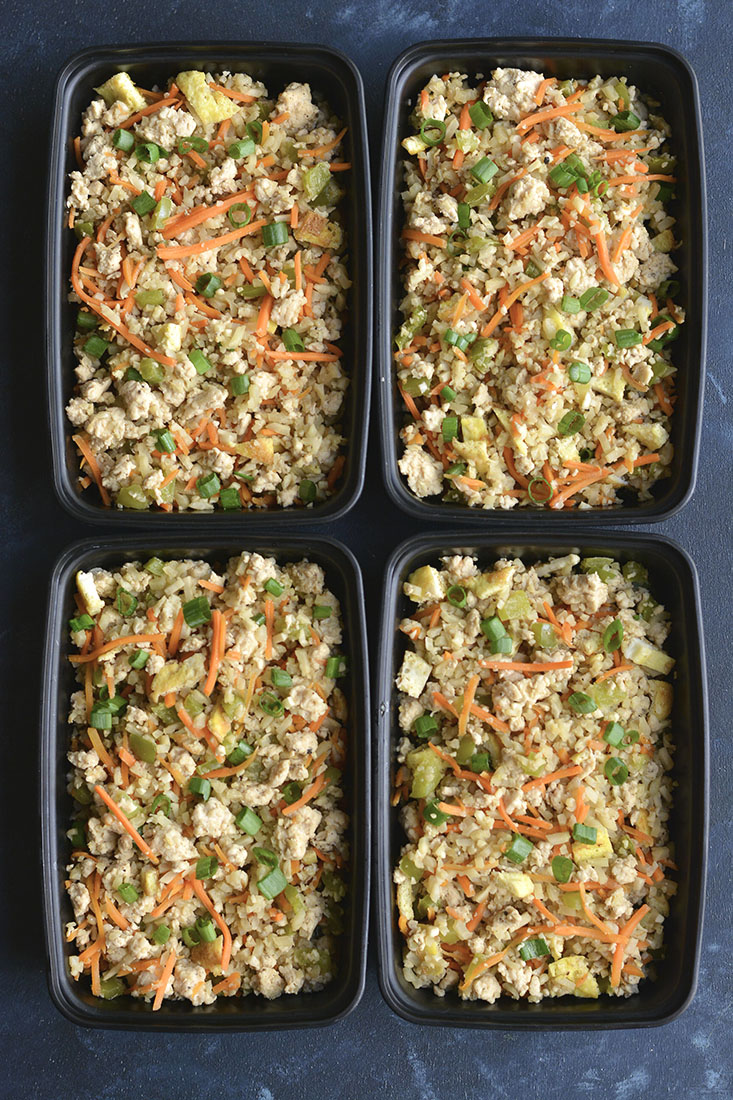 Meal Prep Chicken Cauliflower Fried Rice! Cauliflower rice replaces the grains in this low carb dish. Naturally gluten free, a good source of veggies and incredibly delicious! Low Carb + Paleo + Gluten Free