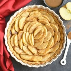 This Almond Flour Apple Pie features an easy to make almond flour crust with sliced apples on top. A dessert recipe that comes together easily, is family approved, Paleo, gluten free and grain free.