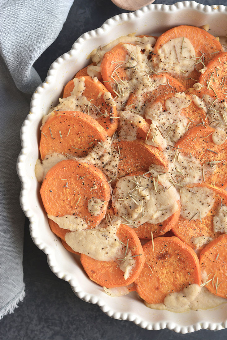 "Whole30 Sweet Potato Au Gratin are sweet potatoes drizzled in a dairy-free cashew ""cream"" sauce. This Vegan and Paleo dish makes an easy side dish to a family dinner or a delicious to your holiday table."
