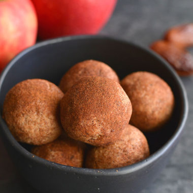 Vegan Apple Cinnamon Peanut Butter Bites! Simple, no bake energy bites with asoft, cookie like texture with the sweetness of cinnamon. Made with good for you ingredients and refined sugar free. A healthy snack the whole family will love! Vegan + Low Calorie + Gluten Free