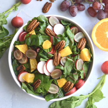 Healthy Holiday Salad! This colorful salad is packed with fresh produce and dressed with an anti-inflammatory turmeric apple cider vinegar dressing. A holiday side salad that's versatile and nutritious!