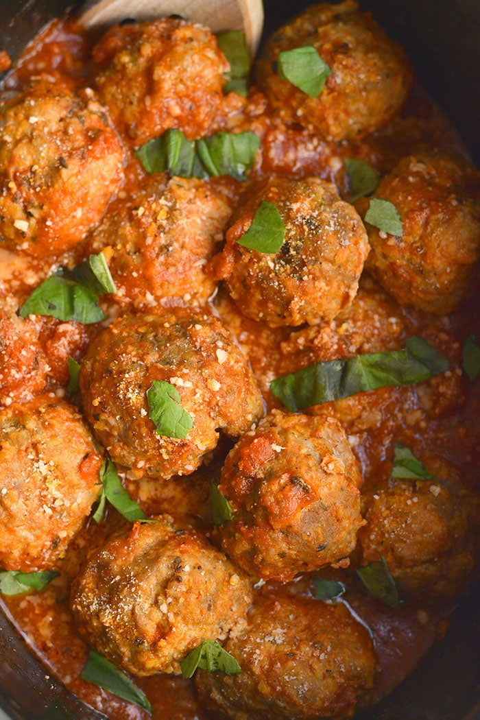 Crockpot Turkey Sausage Meatballs!Thick, juicy, tender meatballs are made with turkey and sausage in a slow cooker. An easy dinner that pleases a crowd! Gluten Free + Low Calorie