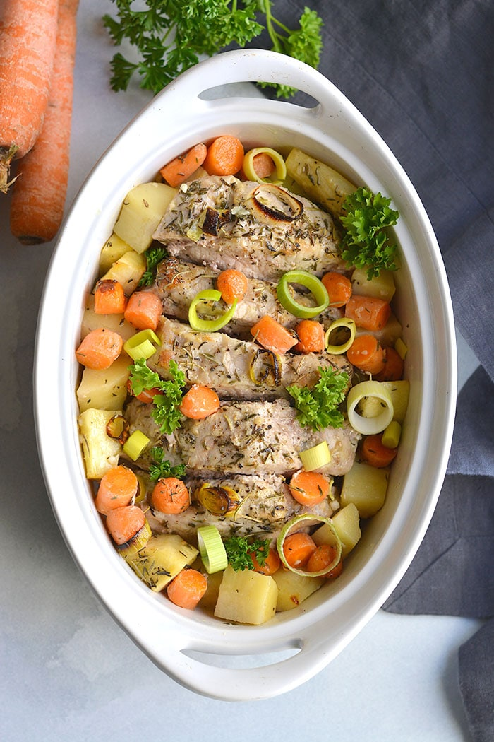 Turmeric Spiced Pork Loin with parsnips, carrots and leeks. Boneless baked pork loin marinated in turmeric, roasted veggies and a sprinkle of herbs. A one-dish Whole30, Paleo, gluten-free meal ready in 30 minutes.