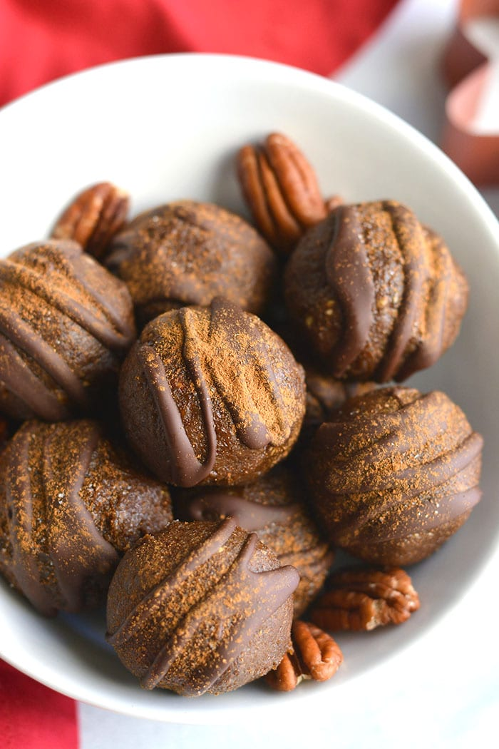 Vegan Paleo Gingerbread Bites!These simple no bake energy bites are made with dates, molasses, pecans and warm spices. An easy, healthy snack for your day! Vegan + Paleo + Gluten Free + Low Calorie