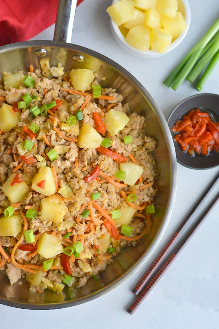 Pineapple Chicken Cauliflower Fried Rice! A simple to make meal packed with delicious flavors the whole family will love. Whole30 compliant, Paleo and incredibly filling! Whole30, Paleo, Gluten Free