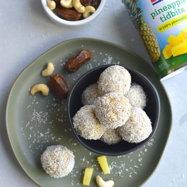 Coconut Cashew Pineapple Bites! These gluten free biteswith a sweet pineapple inside and crunchy coconut cashew outside are the perfect bite sized snack! Paleo + Vegan + Gluten Free + Low Calorie