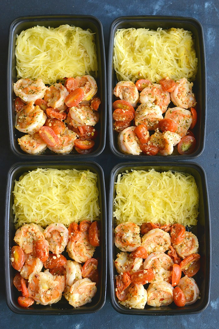 Healthy Shrimp Scampi Spaghetti Squash! Packed with flavor and simple to make. A lower carb meal with more nutrition and a lightened up the sauce!