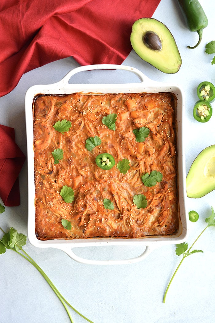 Chicken Enchilada Quinoa Casserole! A wholesome, low sugar casserole packed with protein and incredible flavor. Super easy to make ahead of time and family approved! Gluten Free + Low Calorie