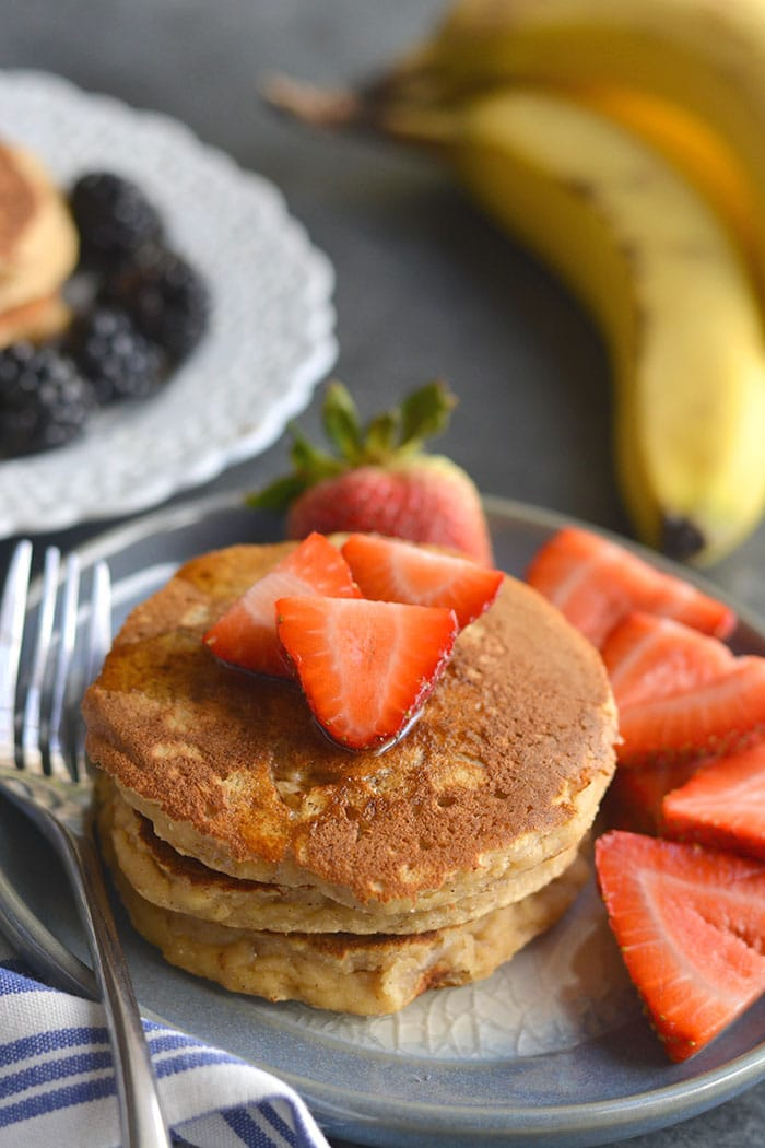 Paleo Coconut Pancakes! Thick, fluffy pancakes packed with fiber, protein and good for you ingredients. Guaranteed fullness and breakfast deliciousness! Paleo + Gluten Free + Low Calorie