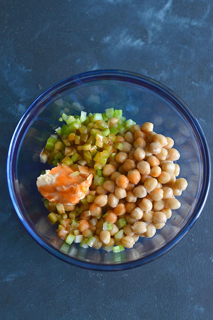 "Meal Prep Buffalo Chickpea Salad! This Vegan salad is similar to a ""chicken salad"" without the meat. Made with chickpeas, hummus and buffalo sauce, this recipe is an easy lunch, dinner or appetizer. Vegan + Gluten Free + Low Calorie"