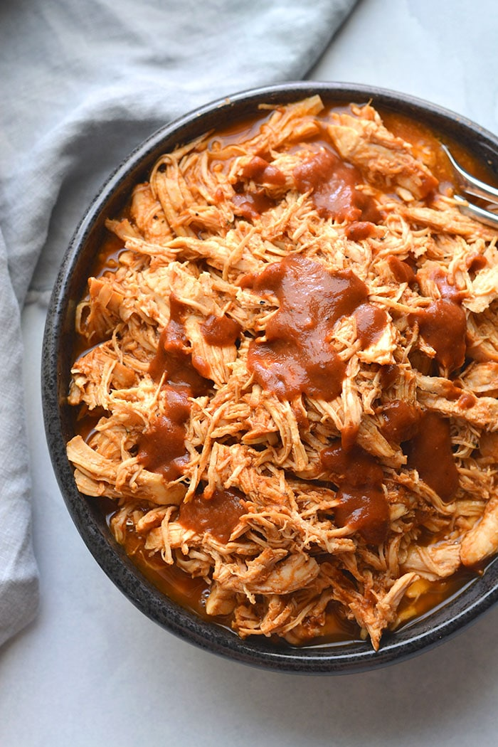 Instant Pot Low Carb BBQ Chicken! Make with a no sugar added BBQ sauce, this Whole30 friendly recipe is quick to make in an Instant Pot in 30 minutes. Toss on a salad, over bread, rice, cauliflower rice or sweet potatoes for an easy meal. Whole30 + Low Carb + Paleo + Gluten Free + Low Calorie
