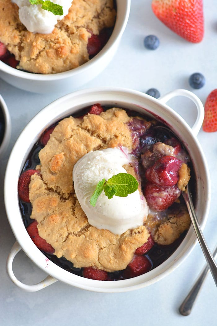 Paleo Berry Cobbler! An irresistible dessert with a delicious almond flour topping! Dairy free, Vegan friendly, easy to make and customize too!