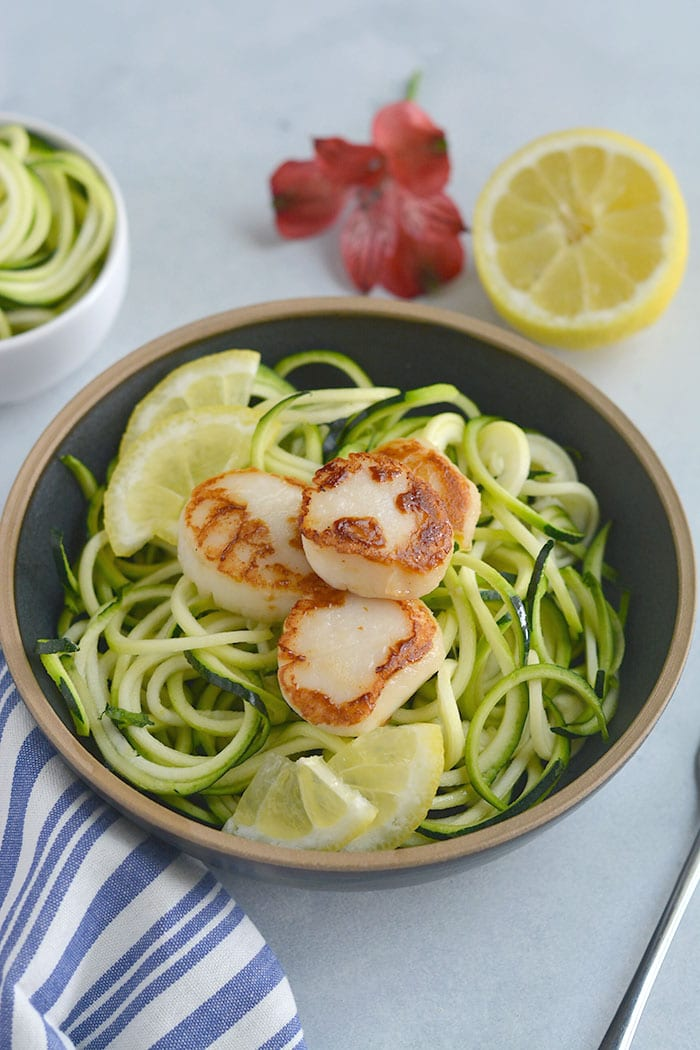 EASY Whole30Lemon Garlic Scallops Zucchini Noodles withsautéed zucchini noodles. One pan and 10minutes is what you need for this healthy, low carb meal. Paleo + Whole30 + Low Carb + Low Calorie + Gluten Free